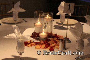 Wedding centerpieces without flowers candles are tried and true favorites for wedding centerpieces without flowers more appropriate for evening occasions candles can be displayed in countless junglespirit Image collections