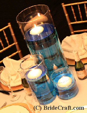 searching for an easy floating candle centerpiece for your do it yourself wedding consider this super simple design your guests will be pleased with the
