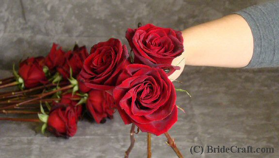 Step 5 To begin making the basic shape of rose wedding bouquets